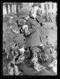 Child with pigeons in Trafalgar Square, London, 7 December 1934.