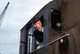 Driver looking out of locomotive cab, Rotterdam, Netherlands, July 1962.