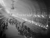 Passengers at Paddington Station, London, 31 July 1943.
