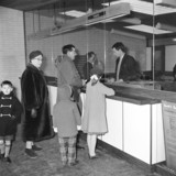 Passengers at the ticket office at Benfleet station, Essex, 1 February 1962.