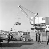 Cars being loaded onto a ship at a harbour on Guernsey, 6 October 1971.