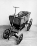 Four-wheeled child's carriage, c 1845.