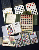 Sample cards of coloured casein plastic buttons, c 1950s.