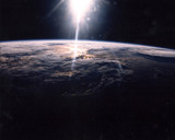 Sunlight over Earth as seen by STS-29 crew , 18 March 1989.