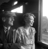 Passengers in a railway carriage, 1950.