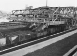 Steel coal wagons being filled at a colliery, c 1960s.