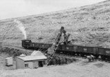 Train of iron ore tippler wagons in a quarry.