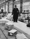 British Transport policeman in a goods depot.