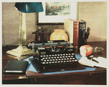 Advertisement with typewriter on desk, c 1927.