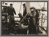 'Hauling in a Minesweeping Cable', c 1916.