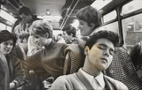 Cliff Richard asleep on a coach while on tour, 1963.