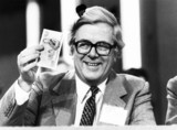 Chancellor Geoffrey Howe with a five-pound note, 16 October 1981.