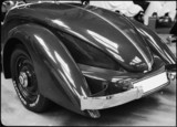 Rear view of a streamlined motor car, c 1934.