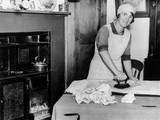 Woman ironing in the kitchen, 1 October 1936.
