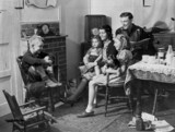 Family in their new prefabricated house, 24 October 1944.