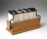 Grove battery comprising five cells in a wooden tray, 1895.
