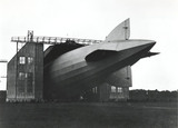 Zeppelin airship LZ 126 being reversed out of its hangar, 1924.