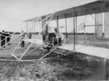 Wilbur Wright on his aeroplane at Hunaudieres, France, August 1908.