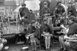 Band of women musicians in uniform, preparing to play at a festival, 1969.