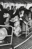 Riding the merry-go-round at Maidstone May Queen Fair, 1968.