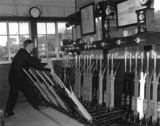 Operating the points levers at Horsted Keynes signal box, c 1955.