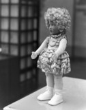 A large curly headed doll, Selfridges Depar