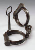 Pair of iron handcuffs, 19th century.