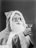 Father Christmas drinking a toast, 1950.