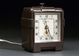 Synchronous mains electric clock of the non self-starting type, c 1936.