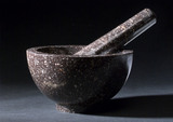 Maroon marble bowl shaped mortar and tapering pestle, c 1800.
