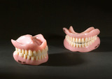 Upper and lower denture set and two odd full lower sets, 1955-1965.