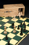 Chess board with chess pieces and box, c 1990.