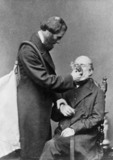 Clover demonstrating chloroform administration with his apparatus, 1862.