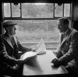 Old man talking to Colin Wills of the BBC during a train journey, 1950.