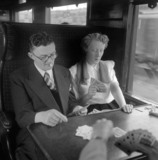 Playing cards during the journey to St Pancras, 1950.