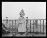 'One Of The Adams Children Wearing Mask...', c 1900.