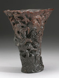 Rhinoceros horn cup with carved decoration.
