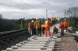 Workers laying track, 1999.