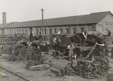 Workers putting wagons together, South Yorkshire, c 1916.