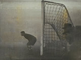 Moscow Dynamo keeper Khomich peers into the pitch gloom, 1945.