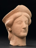 Terracotta head, 300 BC-100 AD.