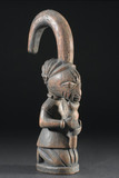 Wooden figure representing the god Eshu, Nigeria, 1880-1920.