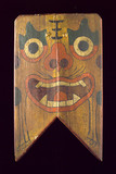 Wooden shield painted with a demon's face, Chinese, 19th century.