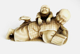 Netsuke of a man being massaged, Japanese, 18th or 19th century.