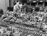 Boy with toy soldiers, January 1972.