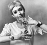 Model Charlie with watches, July 1967.
