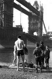 Boys by the River Thames at Tower Bridge, London, c 1910s.