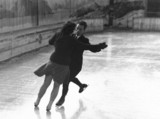 Couple ice-skating, c 1930s.