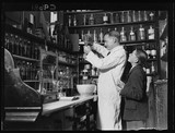 Chemist making cough mixture, 1934.