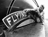 Woman polishing the Flying Scotsman's nameplate, May 1980.